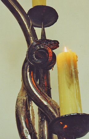detail of rams head on candle holder